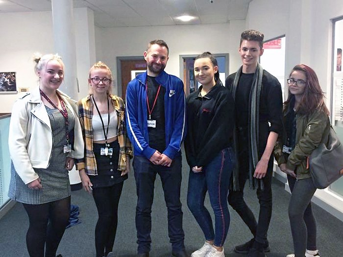 Danny with students at the college