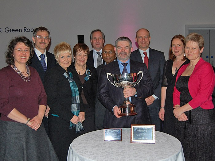 The Gilbert Leferve Memorial Trophy with members of staff from Tameside College