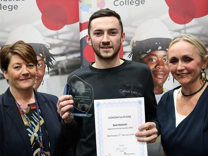 Sam Etchells receiving his award