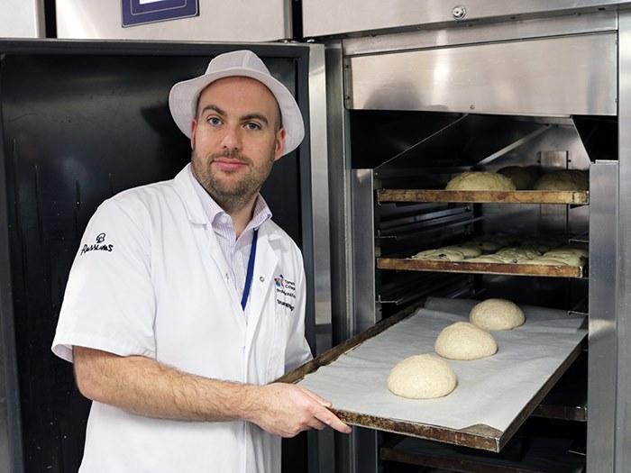 Teacher Stuart operating the bakery ovens