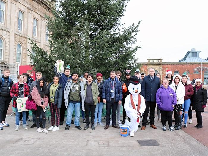 Students pose in Ashton town centre