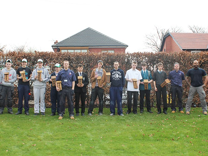 Local school pupils and college staff and students with their bird boxes.