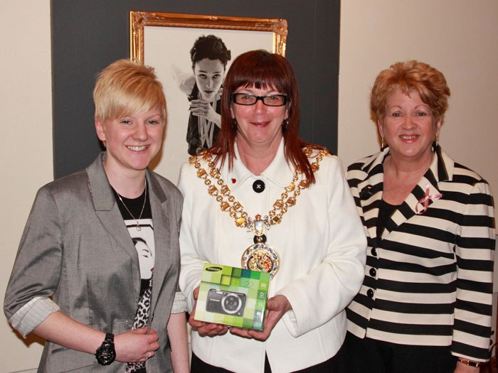 Catherine receiving her prize from the Worshipful Civic Mayor of Tameside, Councillor Susan Quinn.
