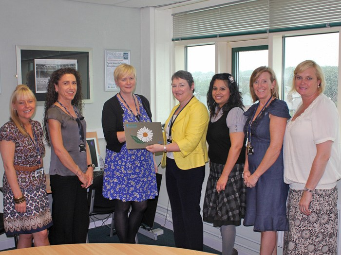 Sonia Bellamy (2nd from left), receiving the Daisy Accreditation on behalf of the team