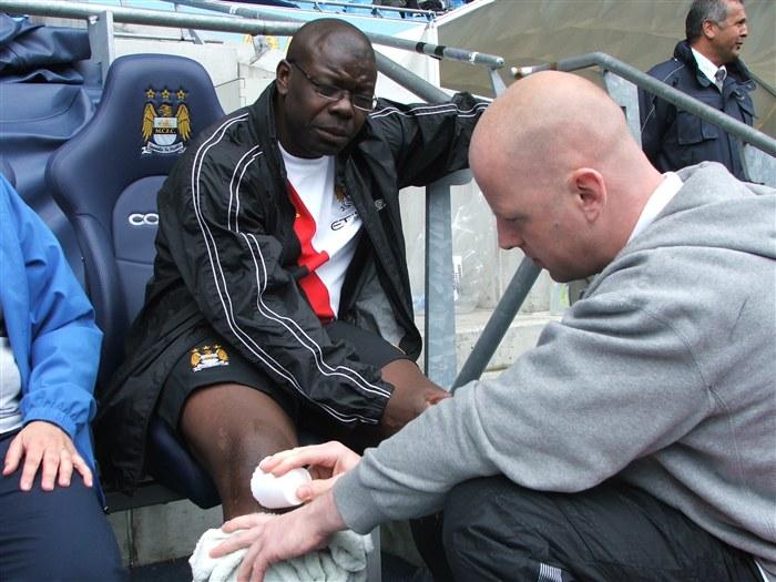 An injured footballer receiving treatment