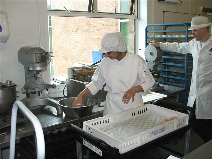 Umaira Fiyaz prepares dougnuts with Steve Salt