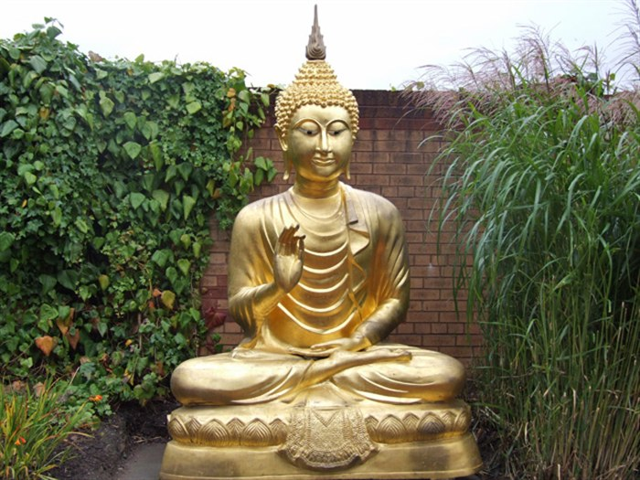 The Golden Buddha located in the College grounds