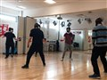 Champion helps students to master fencing