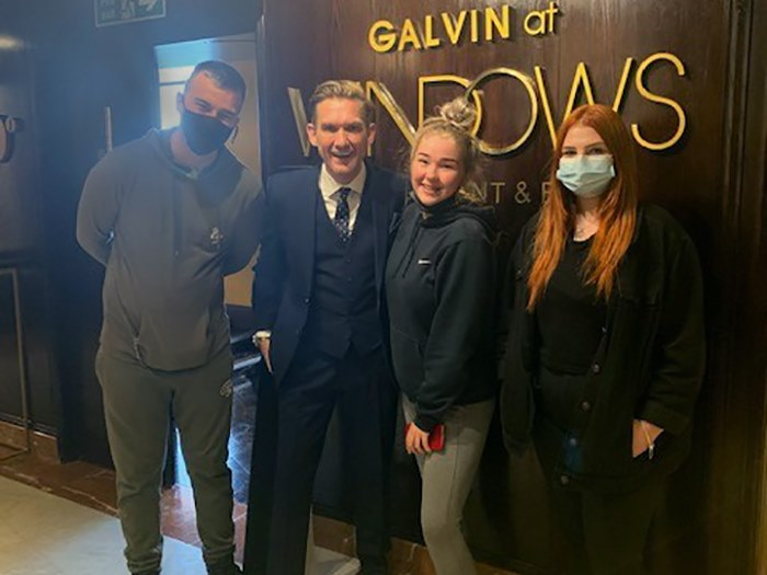 Students with general manager Peter