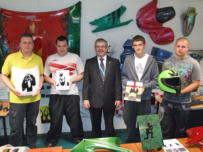 Principal Peter Ryder with some of the entrants to the competitions and their work.