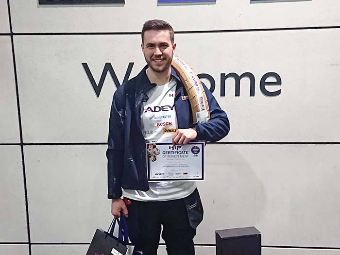 Daniel with his certificate and prizes