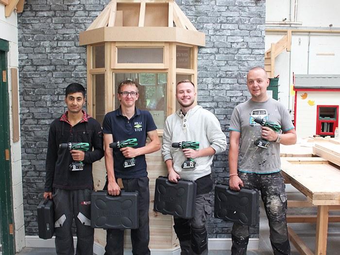 Students Ijaz, Thomas, Thomas and Gareth with the new power tools.