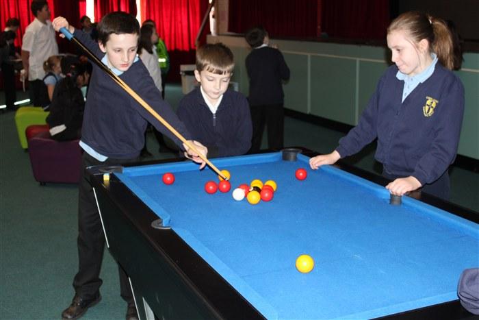 Pupils enjoying playing pool
