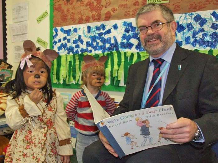 Peter Ryder reading to the children in the nursery