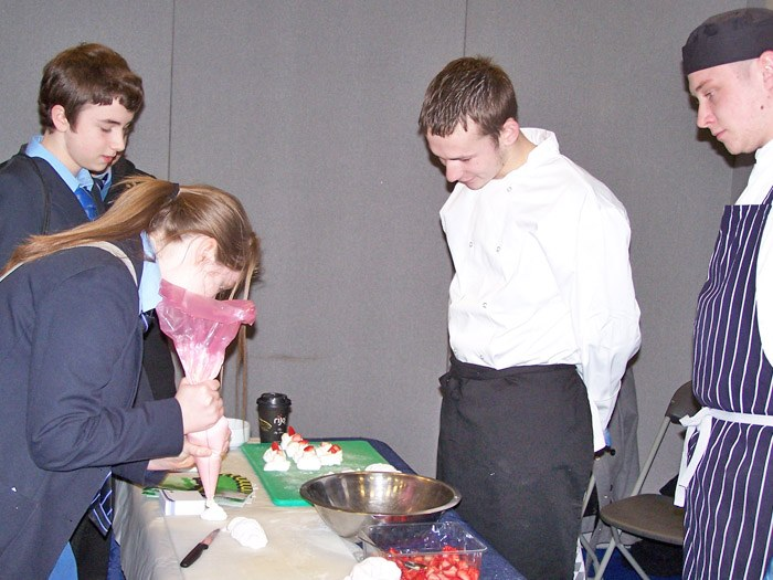 School pupils practicing some piping at the exhibition