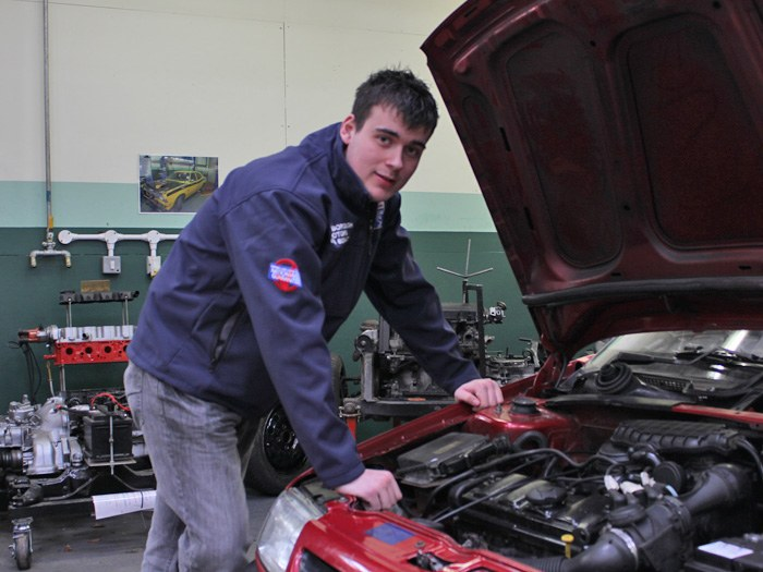 Nathan in the Motor Vehicle workshop.