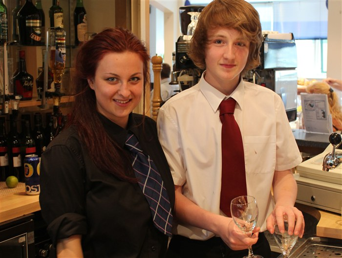 Level 2 Cookery student Georgia-Rae Astbury helps Joshua Cavanah on bartending duty