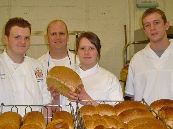 Harry Clegg, Andrew Jones (Test Baker), Gabrielle Baxter and Cameron Potts at the factory