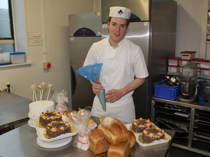 Oliver preparing a selection of tasty bakery goods