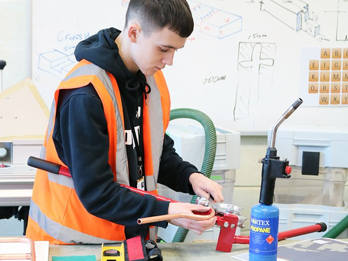 A student competing in the plumbing competition