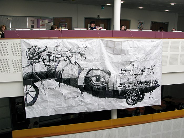 The students' mural hangs in the college atrium