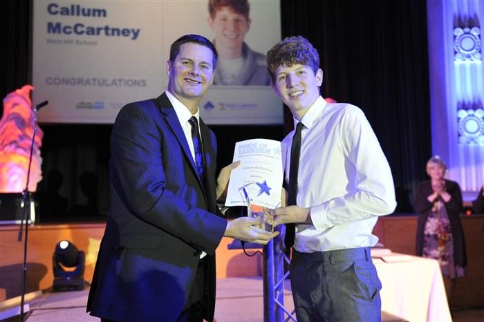 Callum McCartney receiving the GCSE Achievement Student of the Year Award.