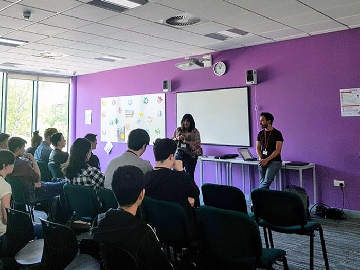 Putul talking to students