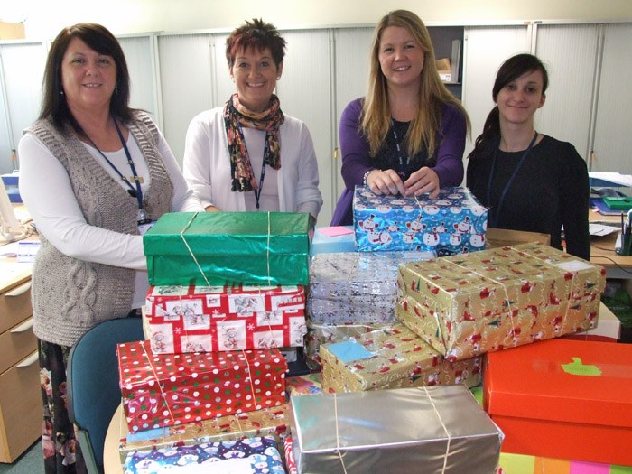 The Human Resource team preparing the Soldier Gift Boxes.