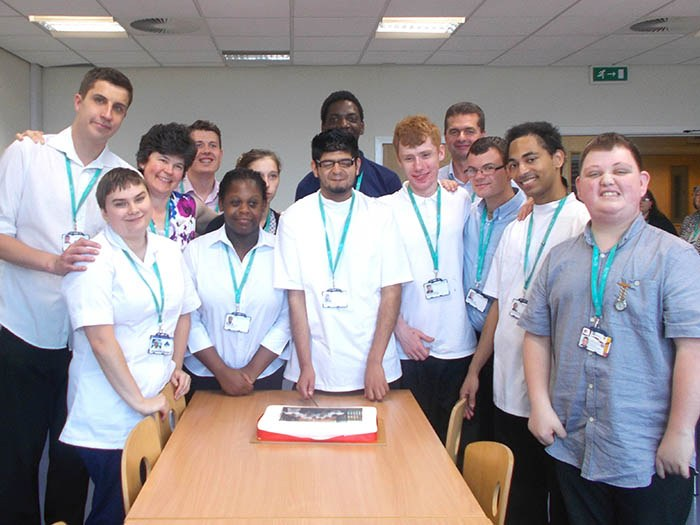 Supported Internship students celebrate their year at Tameside Hospital with a spot of cake