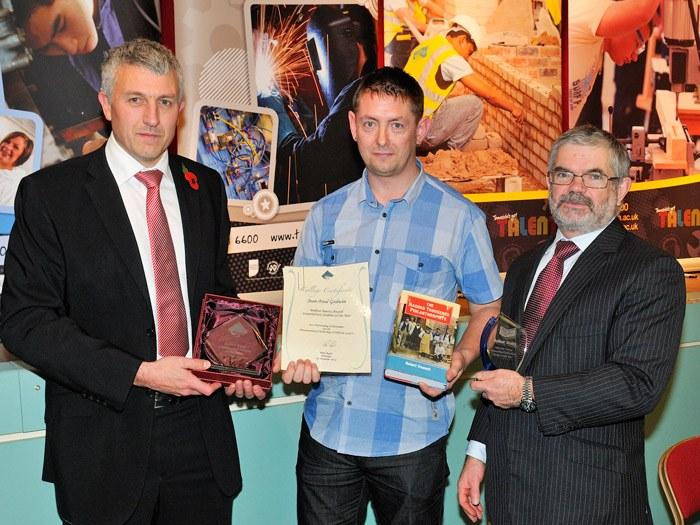 Jean-Paul Godwin receiving his award