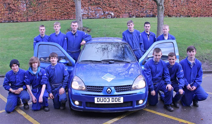 Motorsport students posing for a photo with their 172bhp Renault Sports Clio.
