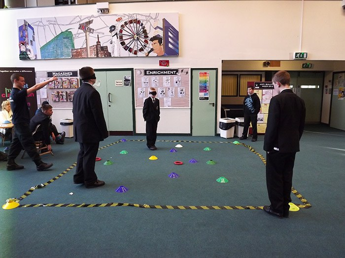 Pupils taking on the Public Services obstacle course whilst blindfolded!
