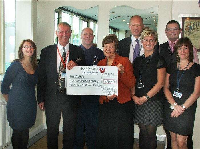Jenny Worsdale presenting the donation to Chris Byrom.