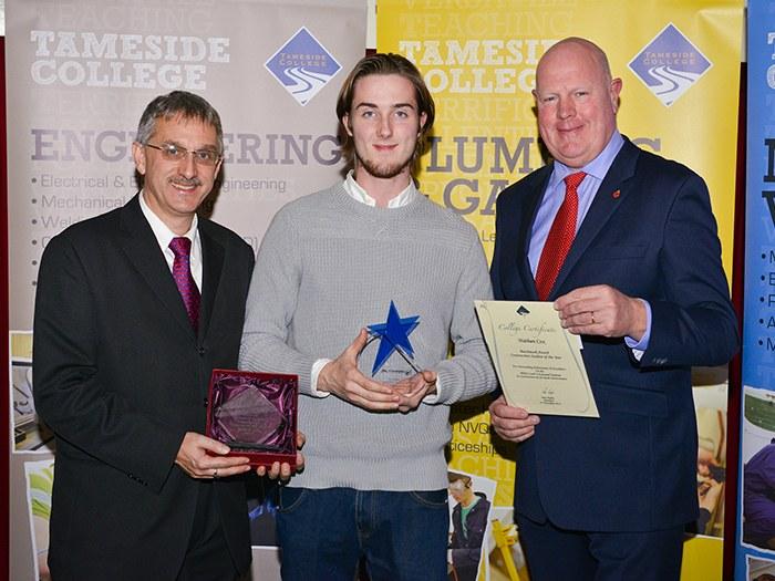 Nathan Cox receiving award.