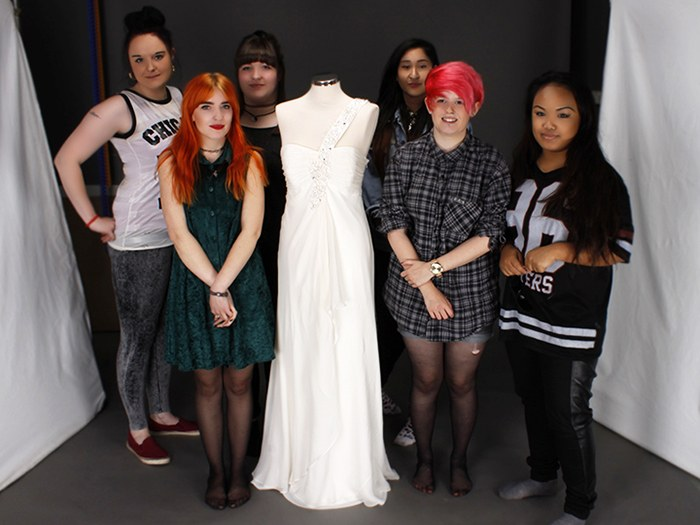 Photography students with one of the dresses.