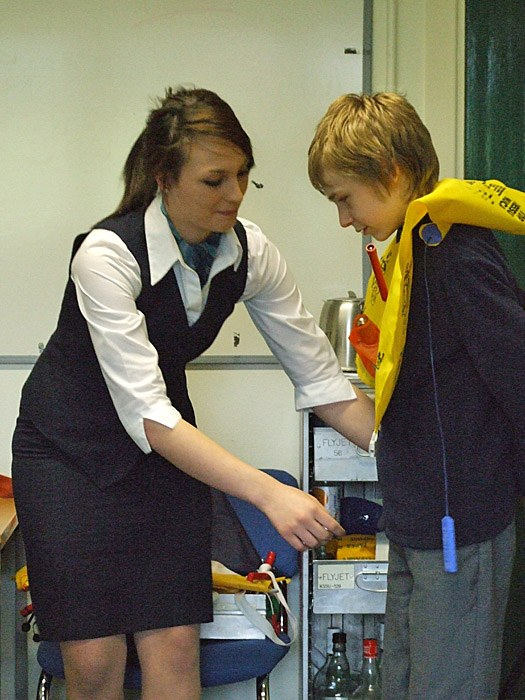 Practising the flight safety demonstrations