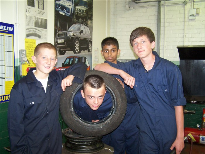 Year 9 pupils having fun in the Motor Vehicle department.