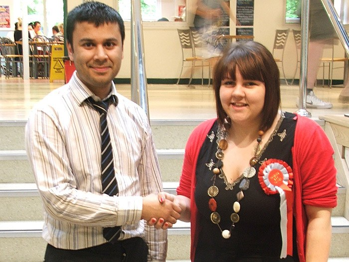 Shayer Hussain congratulating the new Student President, Vicky Heywood