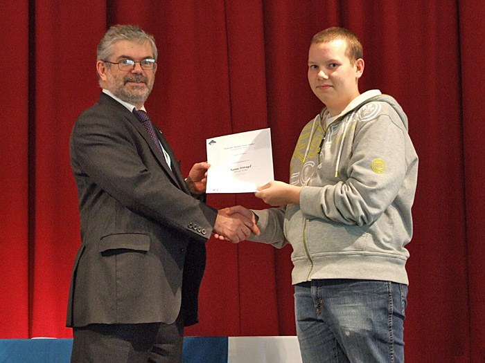 Peter presenting a well deserved certificate to Bakery student