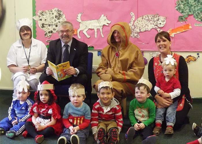 Principal, Peter Ryder, reading the popular Grimms' fairy tale, The Gingerbread Man, to children in the college Nursery.